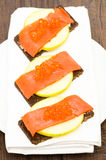 Canapes with salmon, caviar and apple Stock Photography