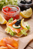 Canapes with salmon and caviar Stock Image