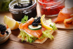 Canapes with salmon and caviar Stock Photos