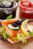 Canapes with salmon and caviar Stock Photography