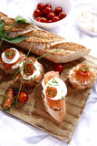 Canapes with salmon and cheese. Close up of bread with slamon, tomatos and cheese Royalty Free Stock Photo