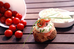 Canapes with salmon and cheese. Close up of bread with slamon, tomatos and cheese Royalty Free Stock Photos