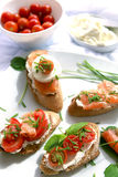 Canapes with salmon and cheese. Close up of bread with slamon, tomatos and cheese Royalty Free Stock Image