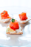 Canapes with salmon cheese  and lime Royalty Free Stock Photo