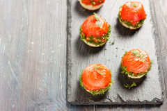 Canapes with salmon and curd cheese Royalty Free Stock Image