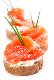 Canapes with salmon and onion Royalty Free Stock Photography