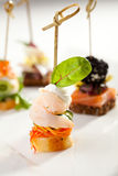 Canapes. Seafood and Vegetables Canapes Dish Stock Image