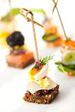 Canapes. Seafood and Vegetables Canapes Dish Stock Images