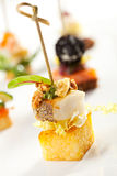 Canapes. Seafood and Vegetables Canapes over White Stock Photos