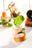 Canapes. Seafood and Vegetables Canapes over White Royalty Free Stock Photography