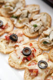 Canapes serve on white plate Royalty Free Stock Photos
