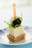 Canapes. On a skewer cheese  with olive Royalty Free Stock Photo