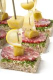Canapes on skewers Stock Photos