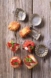 Canapes and small baking molds Stock Images
