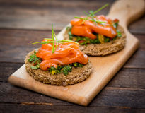 Canapes with smoked salmon royalty free stock photography