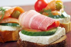 Canapes with smoked salmon ,bacon Royalty Free Stock Photography