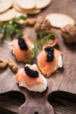 Canapes with smoked salmon and caviar royalty free stock photography