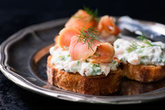 Canapes with smoked salmon and cream cheese spread Stock Photography
