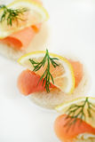 Canapes with smoked salmon and herbs Stock Image
