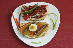 Canapes with smoked salmon, peppers, egg and ham. Tasty bread slices with salmon and ham Royalty Free Stock Photography