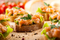 Canapes with smoked salmon Stock Photos