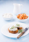 Canapes with soft cheese spread on white plate Stock Photos