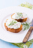 Canapes with soft cheese spread on white plate Royalty Free Stock Images