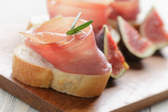 Canapes with spanish jamon Stock Photo