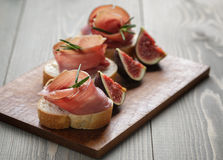 Canapes with spanish jamon Stock Photography