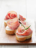Canapes with spanish jamon Stock Images