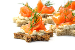 Canapes in star shape with salmon for Christmas or New Year, on Royalty Free Stock Photography