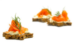 Canapes  in star shape with smoked salmon for a christmas dinner. Canapes for a christmas dinner dark bread in star shape with smoked salmon on cream cheese and Royalty Free Stock Photography