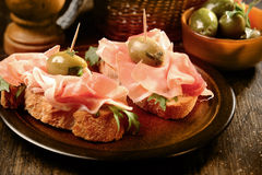Canapes or tapas with proscuitto ham Stock Photo