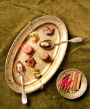 Canapes and tartlets. Canapes and tartlets laid out on an old brass plate Stock Photography