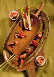 Canapes and tartlets. Still Life with canapés and tartlets laid out on an old wooden and brass ware Stock Photography