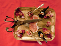 Canapes and tartlets. Still life with scissors, canapés and bacon Royalty Free Stock Photo