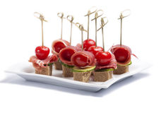 Canapes with tomato and bacon Royalty Free Stock Photos