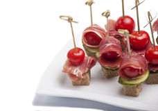 Canapes with tomato and bacon Royalty Free Stock Image