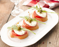 Canapes with tomatoes and mozzarella Stock Photography