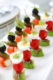 Canapes on toothpicks ,  pinchos Royalty Free Stock Images