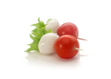 Canapes. Two canapes with tomato and mozzarella on the toothpick Royalty Free Stock Images