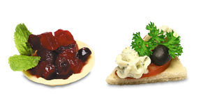 Canapes. Two canapes with vegetables and black olives Royalty Free Stock Photo