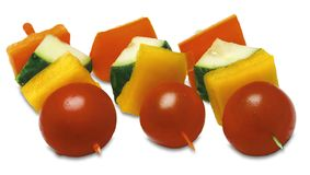 Canapes with vegetables. Canapes with tomatoes and slices of sweet pepper and cucumber Stock Image