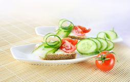 Canapes on white plate Stock Images