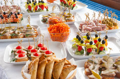 Canapes on the white plates Stock Image