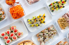 Canapes on the white plates Stock Images