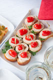Canapes on the white plates Royalty Free Stock Photos