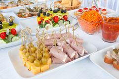 Canapes on the white plates Stock Photography