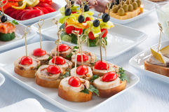 Canapes on the white plates Royalty Free Stock Photo