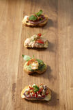 Canapes on wooden background Royalty Free Stock Photo